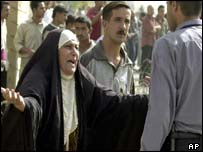 Iraqi woman mourns after bombing