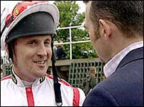 Reporter Andy Davies confronts jockey Graham Bradley