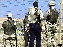 US and Iraqi guards gaze across border into Iran