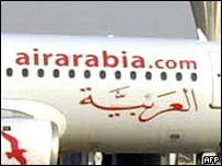 An Air Arabia plane standing ready on the tarmac at Sharjah International Airport
