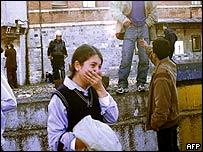Schoolgirl cries outside British consulate