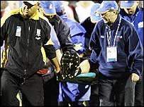 Canadian captain Al Charron is stretchered off the field