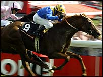 Champion jockey Kieren Fallon guides Kris Kin to glory in the 2003 Epsom Derby