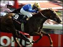 Champion jockey Kieren Fallon guides Kris Kin to glory in the 2003 Epsom Derby