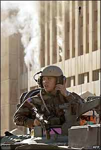 A US soldier guards the Iraqi Oil Ministry after the attack