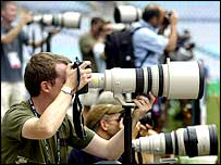 Photographers try and get the best shot at an England training session