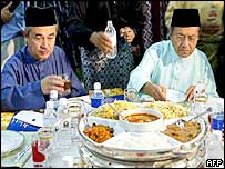 Malaysian Prime Minister Mahathir Mohamad (right) and Abdullah Badawi