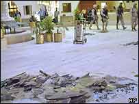 US soldiers move into the Sheraton hotel after it was hit by several rockets