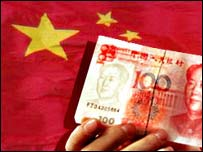 Yuan banknote and Chinese flag