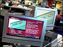 A plasma screen showing a digital text story