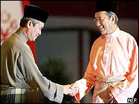 Abdullah Badawi (left) is greeted by Dr Mahathir Mohamad