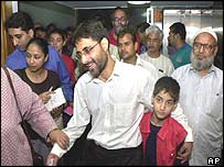 Syed Abdul Rahman Geelani with his son at Delhi press conference