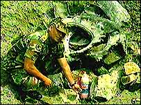 Colombian soldier poses with home-made mine