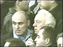Eduard Shevardnadze (centre) is hustled away
