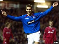 Peter Lovenkrands celebrates the first of his goals