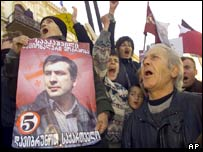 Opposition supporters with poster of Mikhail Saakashvili