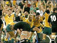 Australia's players celebrate winning the World Cup over New Zealand
