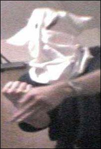 Rob Pulling wore an improvised Ku Klux Klan mask