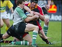 Ian Gough helps Steve Jones over for the opening try