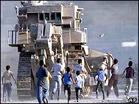 Palestinians throw stones at D-9 bulldozer