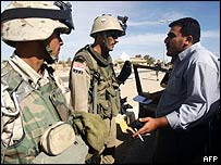 US soldiers stop a man wanting to enter Uja in Iraq