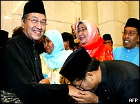 Supporters kissing Mahathir Mohamad's hand