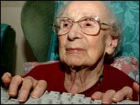 Pensioner using computer, PA