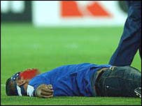 A spectator lies prostrate after trying to tackle South Africa's Louis Koen