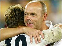 England coach Clive Woodward hugs match-winner Jonny Wilkinson