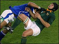Derick Hougaard is tackled by Brian Lima