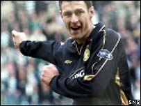 Chris Sutton slots in his first goal of the day