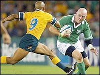 Irish skipper Keith Wood takes on George Gregan of Australia
