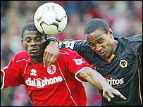 Boro midfielder George Boateng contests possession with Wolves enforcer Paul Ince