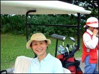 Woman in a golf buggy, Luhu Golf & Country Club, Guangzhou