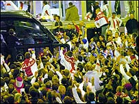 England rugby fans cheer the team onto their coach