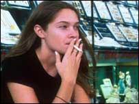 Woman smoking in shop
