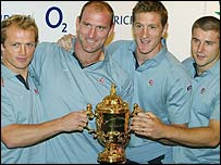 Matt Dawson, Lawrence Dallaglio, Will Greenwood and Ben Cohen show off the World Cup after arriving home