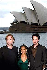 Keanu Reeves, Jada Pinkett Smith and Hugo Weaving in front of Sydney Opera House