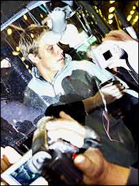 Jonny Wilkinson is mobbed by photographers at Heathrow