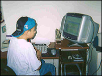 Niza's son at his computer