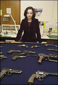 Home Office Minister Caroline Flint with seized guns