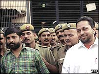 Former Congress party politicans Keshav Kumar (left) and Sushil Sharma surrounded by police