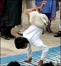Boy does a handstand at the Sucheta Kriplani Shiksha Niketan school.