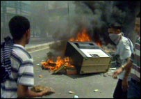A large TV is destroyed during rioting in Jakarta in 1998