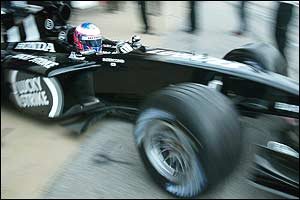 Jenson Button leaves the pits in his modified BAR at Barcelona