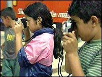 Children taking photos