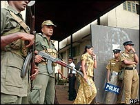 Soldiers stand guard outside government press building