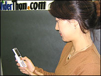 Korean woman using her mobile phone