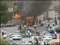 Fire appliance tackles the blaze, near the Baghdad hotel