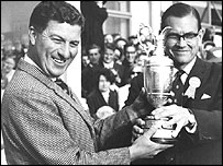 Peter Thomson (left) receives the claret jug in 1965